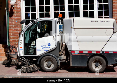 A Bucher Citycat 2020 street washer is seen on the rue St Jean street sidewalk in Quebec city - Stock Photo