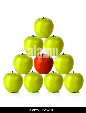 green apples on a pyramid shape - be different - Stock Photo