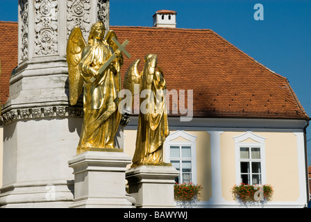 Golden Angel on Fountain in Front of the Cathedral of the Assumption of the Blessed Virgin Mary - Stock Photo