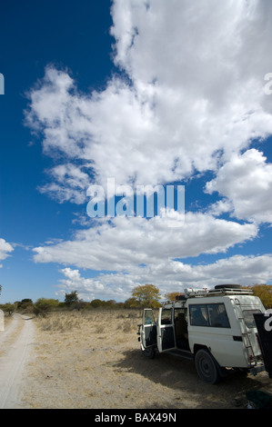 4x4 safari jeep travelling through Africa - Stock Photo