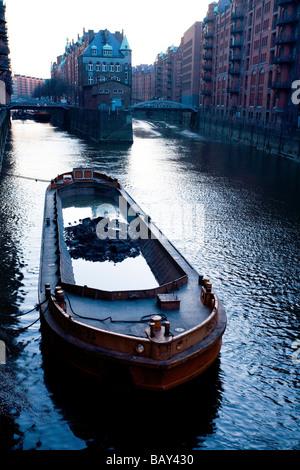 Barge on canal, Speicherstadt, Hamburg, Germany - Stock Photo