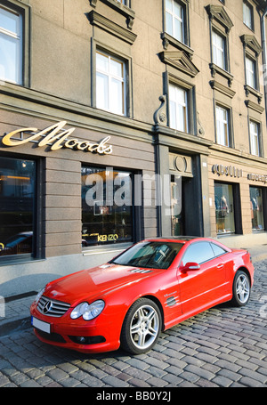Luxury car outside expensive shops in the upmarket area of Tallinn, Estonia. - Stock Photo