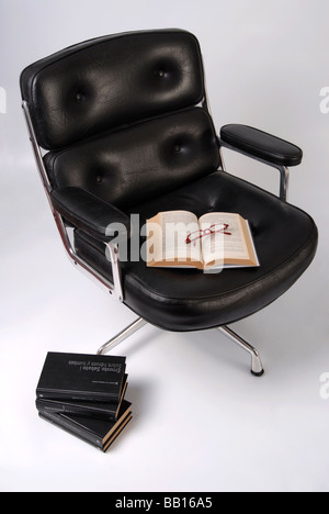 black leather executive chair in a lecture ambient - Stock Photo
