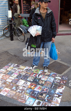 Illegal DVD copies market salesman chinese - Stock Photo