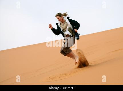 Woman sand skiing, Sosiesvlei, Namibia - Stock Photo