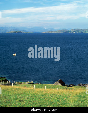 irelands coastal atlantic ocean with small dwelling house, beauty in nature, - Stock Photo