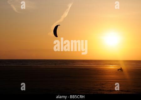 Lone kitebuggy at sunset - Stock Photo