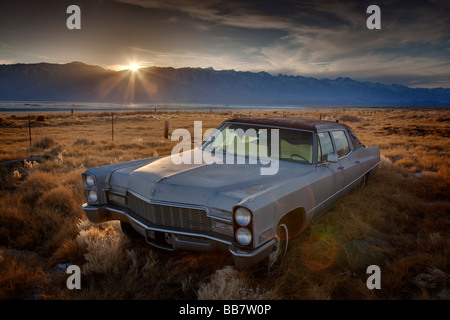 Abandoned Chevrolet automobile in field near Mount Whitney near Lone Pine in California USA - Stock Photo