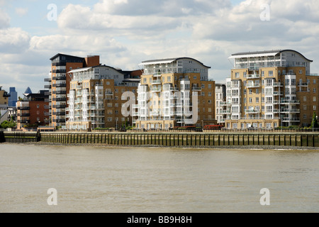 Typical private Thames riverside luxury apartments Isle of Dogs East End London England UK - Stock Photo