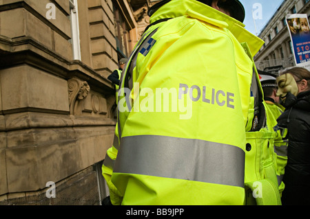 yellow police jacket at gaza protest birmingham - Stock Photo