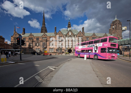 Double decker bus passing The Coventry City Council House in Coventry, West Midlands of England, United Kingdom - Stock Photo