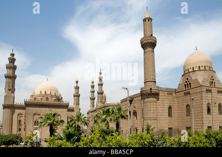 Old Cairo down town Egypt Sultan Hassan mosque left and Ali Al Rifai mosque right - Stock Photo
