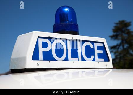 Police flashing light and sign on old 1960s Panda car UK - Stock Photo