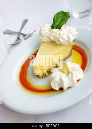 key lime pie slice on plate with two forks - Stock Photo