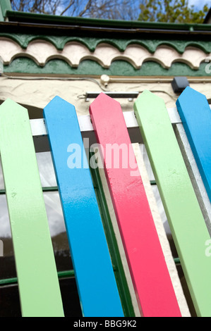 A colourful garden fence outside a house in Cornwall, England, UK - Stock Photo