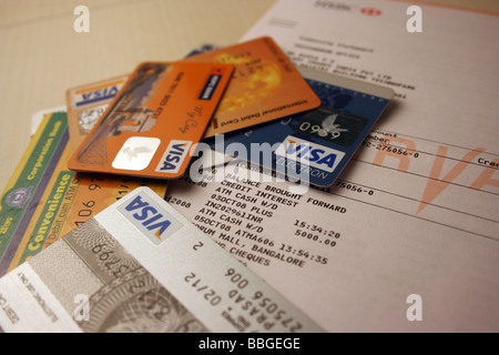 Visa cards lying on a bank statement, spending, expenditure,  recession, Visa, debit cards, credit, bank account, - Stock Photo