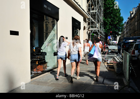 Paris France, Luxury Clothes, Shopping, Parisian Street Scene, Women Walking Away, Outside Prada Store - Stock Photo