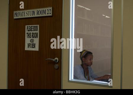 Makhosi Prince Nyamela a student reading in an enclosed libary Photo Antony Kaminju Model released MR0109 - Stock Photo