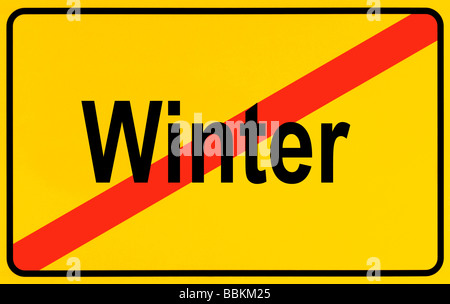 Town exit sign, lettering Winter, symbolic of end of winter - Stock Photo