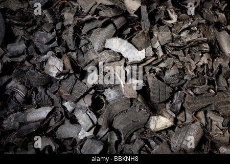 Recycling of tyres The best are stored and shipped to third world countries the bad tires are shredded into granulate - Stock Photo