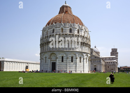 Campo Dei miracoli at Pisa with baptistry, cathedral and leaning tower - Stock Photo