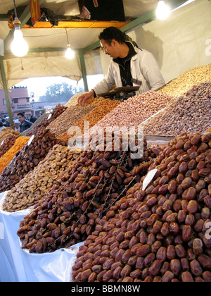Dried fruit and nut stall in Marrakech souk Morocco - Stock Photo