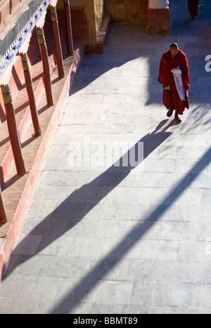 Thiksey Gompa, Ladakh, Jammu and Kashmir, India; Buddhist monk walking through monastery - Stock Photo