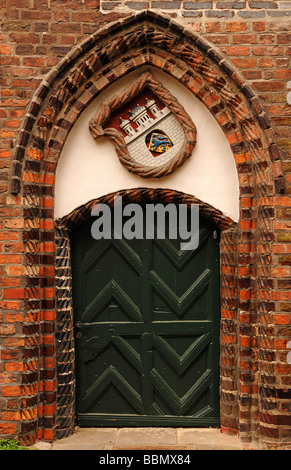 Gothic brick-lined entrance with the town hall's coat of arms, Lueneburg, Lower Saxony, Germany, Europe - Stock Photo