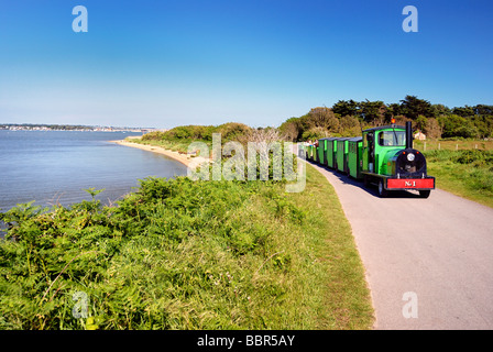 The Noddy land train taking passengers along Hengistbury Head - Stock Photo