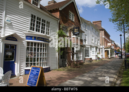 Tenterden Kent England UK May Historic buildings along the tree lined main street of this attractive English village - Stock Photo