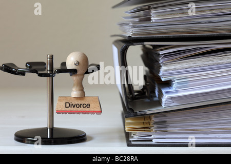 Stamp with inscription Divorce next to a pile of files - Stock Photo