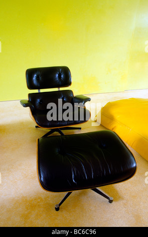 Black Leather Eames Chair With Foot Stool - Stock Photo