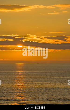 Sunset Over The Bristol Channel North Devon England - Stock Photo