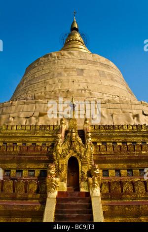 Front of the ancient Shwezigon Pagoda in Bagan, Myanmar - Stock Photo
