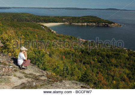 An elementar age boy enjoys the view from Gorham mountain. - Stock Photo