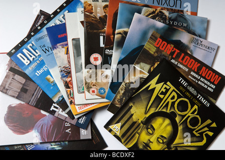 A selection of DVD's given away free with British newspapers - Stock Photo