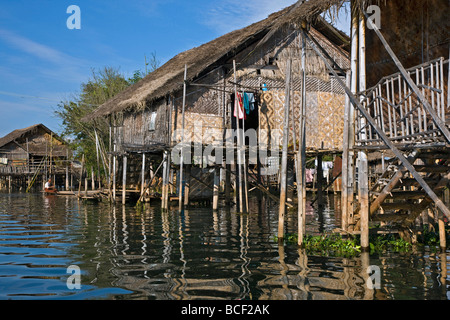 Myanmar, Burma, Lake Inle. Typical Intha houses on stilts in Lake Inle. The patterned walls are made of woven bamboo. - Stock Photo