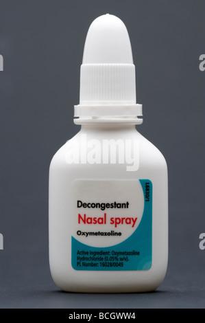 Decongestant nasal spray bottle - Stock Photo