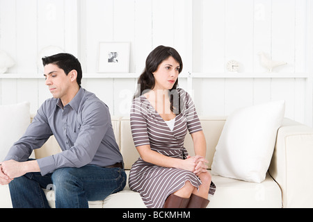 Hostile couple in a living room - Stock Photo