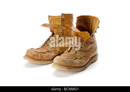 old pair of work boots on white background - Stock Photo