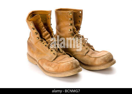 Old steel toed work boots on white background - Stock Photo