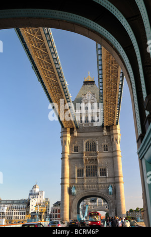Looking through one of the arches of Tower Bridge London England UK across to the other tower - Stock Photo