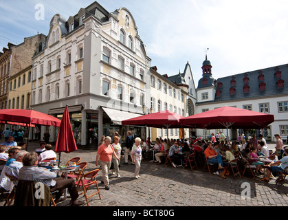 Tourists sitting in a café on Jesuitenplatz Square, Koblenz, Rhineland-Palatinate, Germany, Europe - Stock Photo