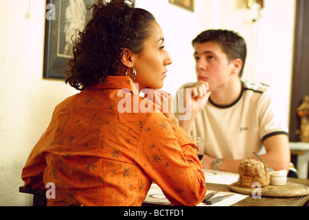 Bored couple having a meal in a restaurant,could be fist date - Stock Photo
