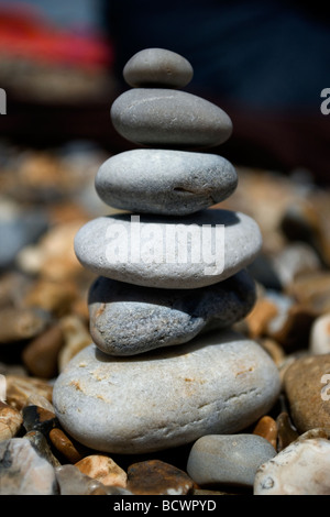 Pebble tower on Aldeburgh beach, Suffolk, UK. - Stock Photo