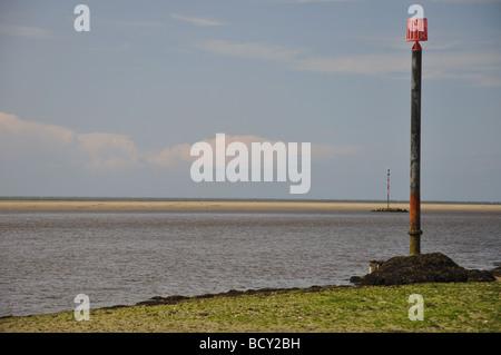 Channel markers River Teifi estuary bar - Stock Photo