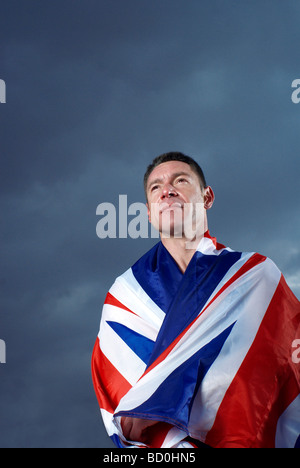 athlete wrapped in U.K. flag - Stock Photo