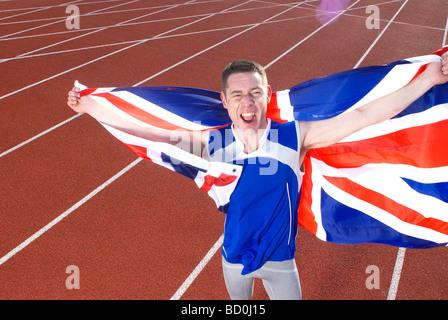 athlete holding flag - Stock Photo