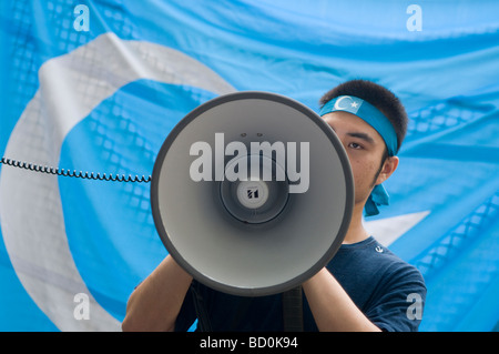 A supporter of Turkistan Islamic Movement (TIM) founded by Uyghur jihadists taking part in a protest in Xinjiang - Stock Photo