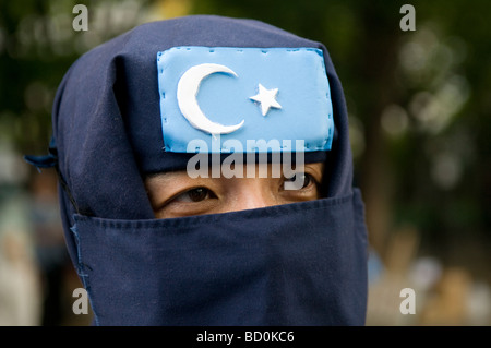 A veiled supporter of the Turkistan Islamic Movement (TIM) founded by Uyghur jihadists in Xinjiang Uyghur Autonomous - Stock Photo